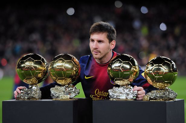 barcelonas-argentinian-forward-lionel-messi-poses-with-his-4-fifa-ballon-dor-trophies-prior-to-the-spanish-copa-del-rey-1404807659-1411481